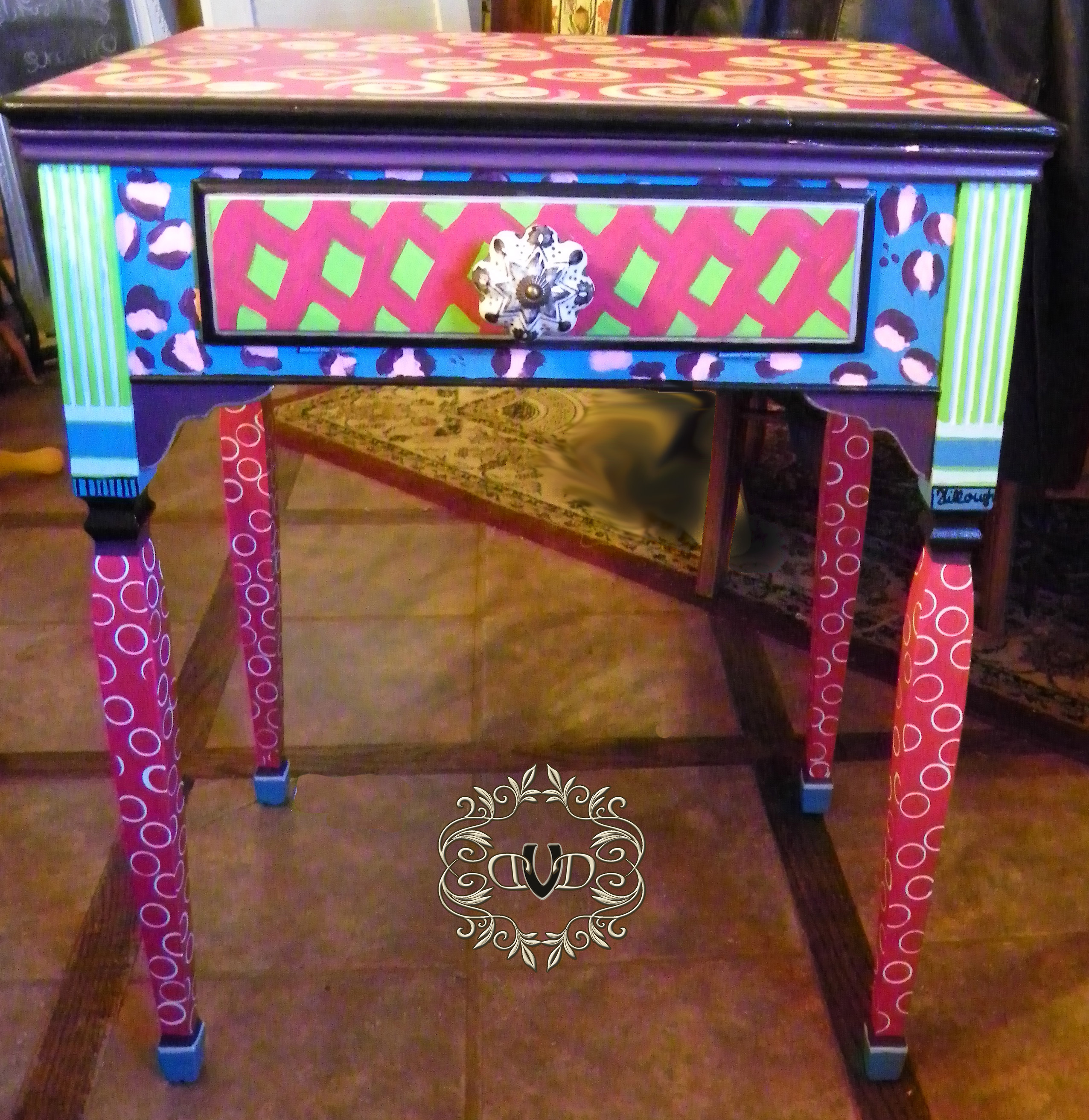 Multi colored sewing table