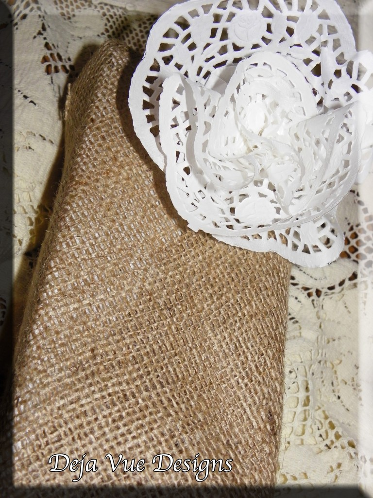 Gift wrapped in burlap and accented with a doily bow