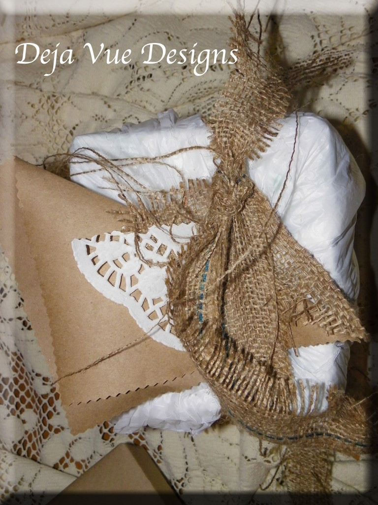 gift wrapped in plastic bags and accented with paper, burlap and lace