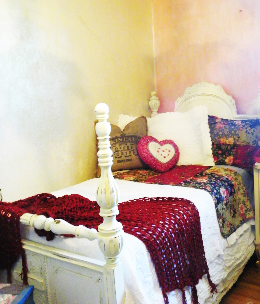 four poster bed with creamy white paint