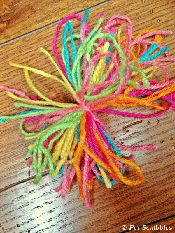 Make a pom-pom with your leftover yarn scraps!