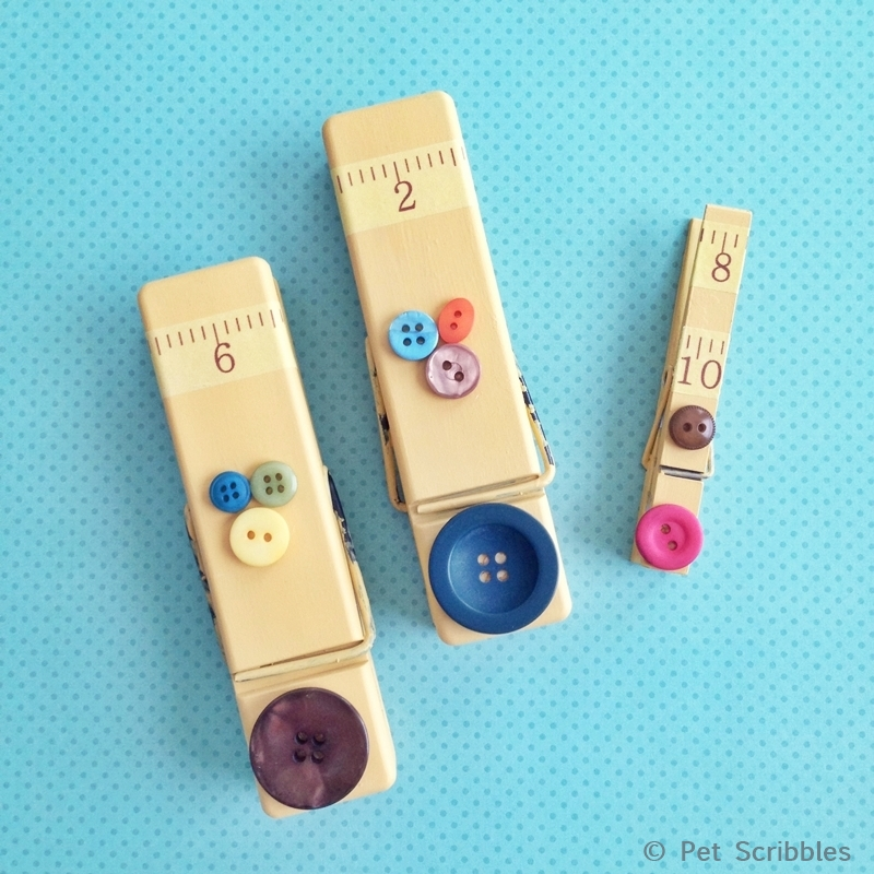 Easy clothespin magnet makeover with paint, buttons and washi tape!