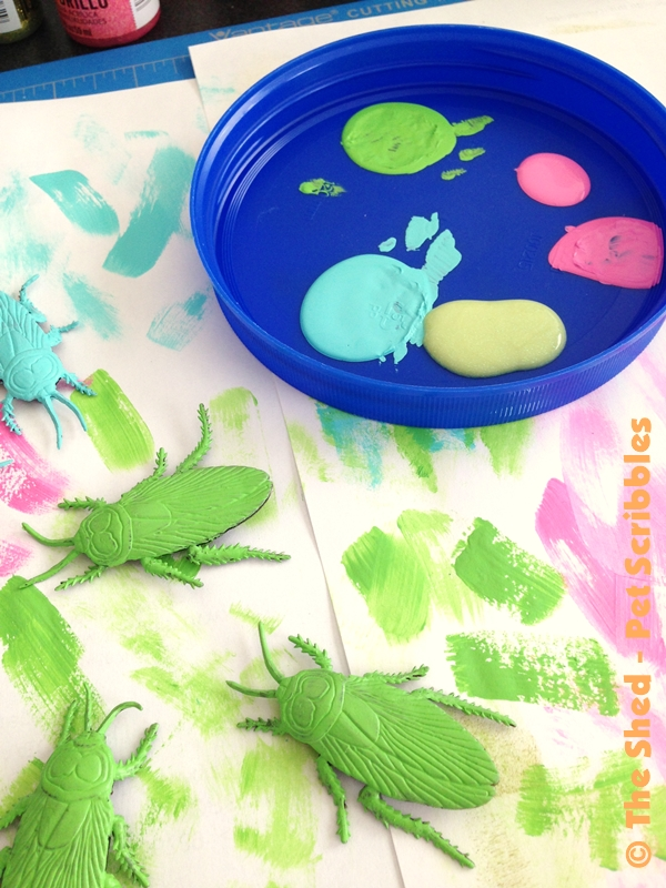 painting plastic bugs