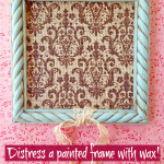 Distress a painted frame with wax!