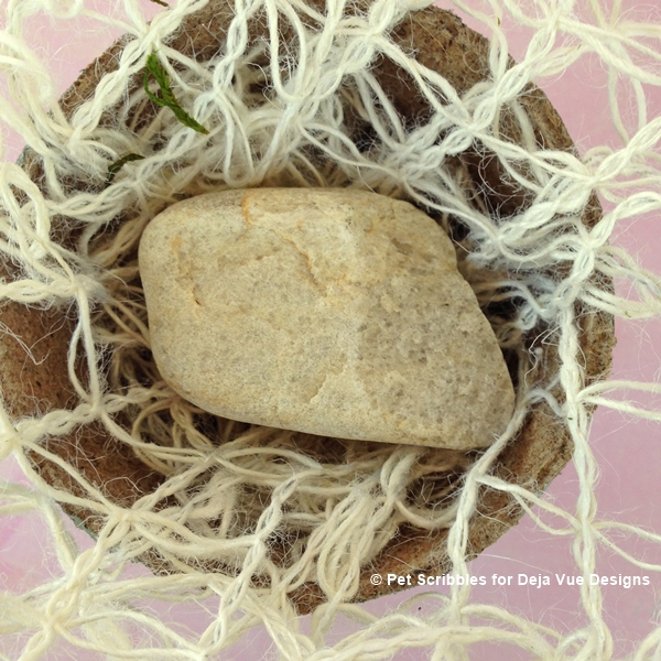 use a rock to weigh down peat pots for decorative use