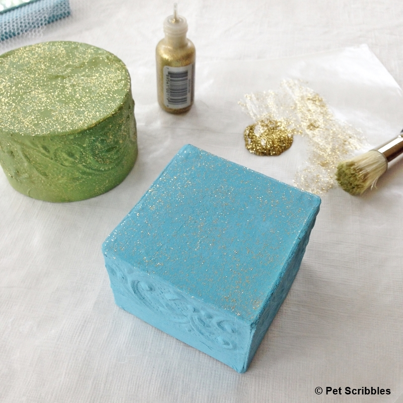 gold glitter on painted paper mache boxes