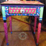 Coat of many colors multi colored sewing table